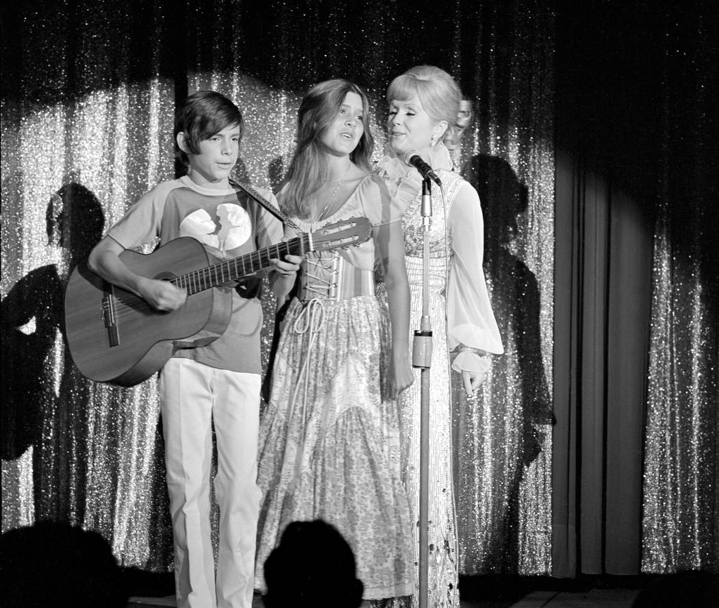 Debbie Reynolds is joined onstage by daughter Carrie Fisher and son Todd Fisher on the opening night of her run at Desert Inn on Wednesday, July 28, 1971, in Las Vegas. (Jim Borrup/Las Vegas News ...