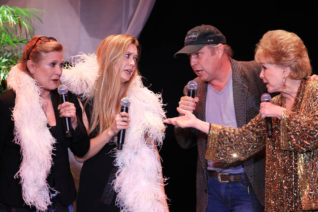Debbie Reynolds, joined by daughter Carrie Fisher, son Todd Fisher and granddaughter Billie Lourd, performs in her penultimate show Saturday, Nov. 8, 2014 the South Point showroom. (Sam Morris/Las ...