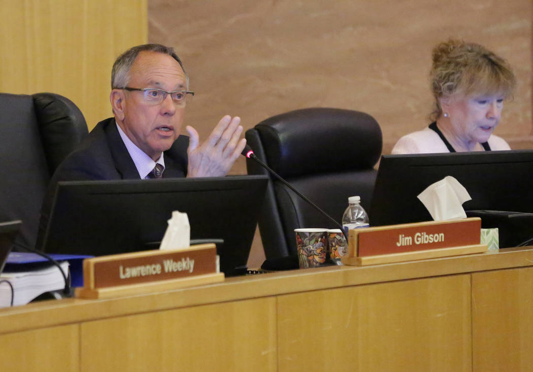 Clark County Commissioner Jim Gibson poses a question to Director of the Clark County Department of Air Quality, Marci Henson, about a resolution seeking federal legislation to open almost 39,000 ...