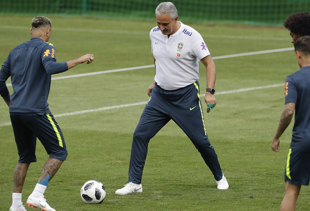 Brazil head coach Tite, right, and Neymar practice during a training session in Sochi, Russia, Tuesday, June 19, 2018. Brazil will face Costa Rica on June 22 in the group E for the soccer World Cu ...