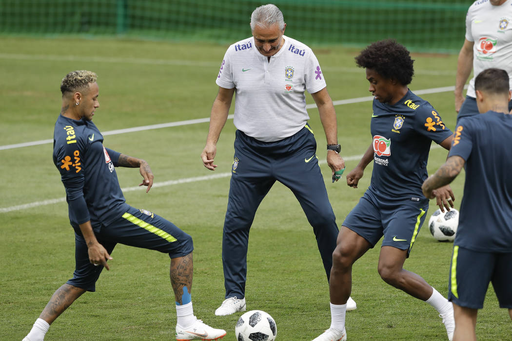 Brazil head coach Tite, center, Neymar, left, and Willian practice during a training session in Sochi, Russia, Tuesday, June 19, 2018. Brazil will face Costa Rica on June 22 in the group E for the ...