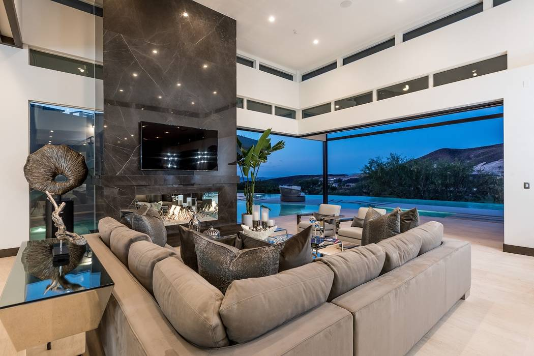 This nearly $8 million home in MacDonald Highlands features disappearing walls. (Sun West Custom Homes)