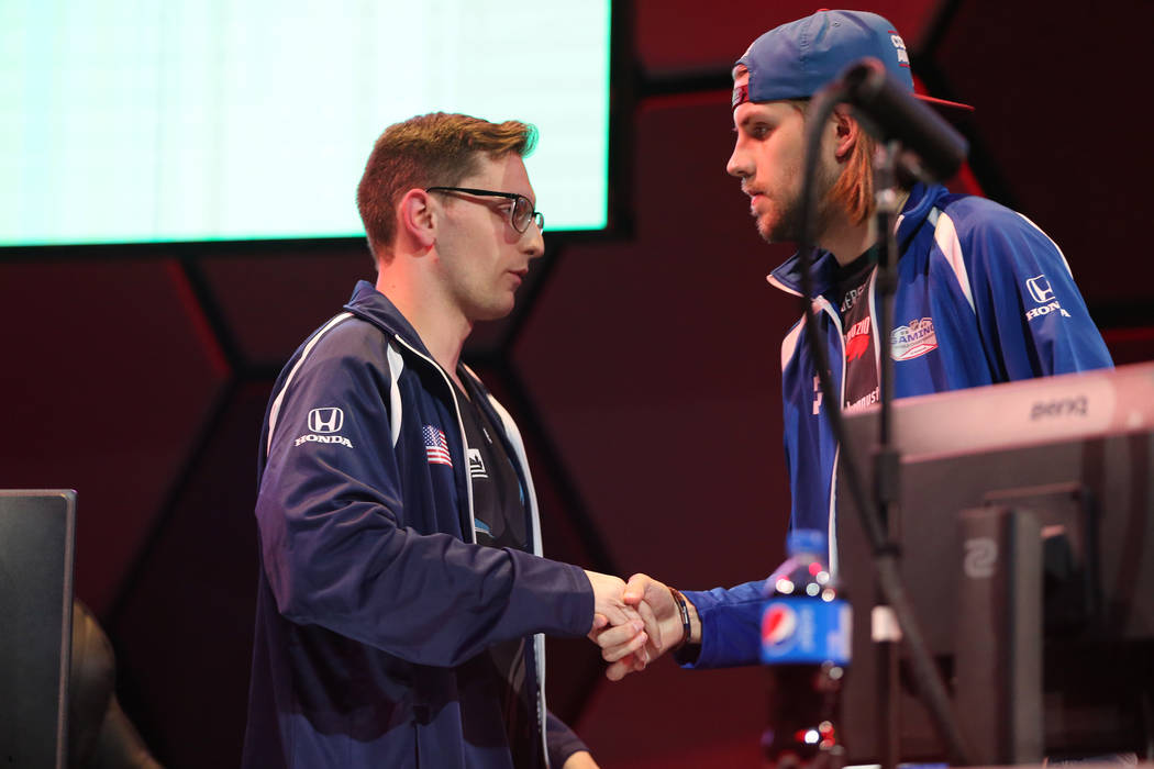 David Roebuck, left, and Arttu Mustila shake hands after their game in the NHL Gaming World Championship at Esports Arena inside the Luxor casino-hotel in Las Vegas, Tuesday, June 19, 2018. Erik V ...