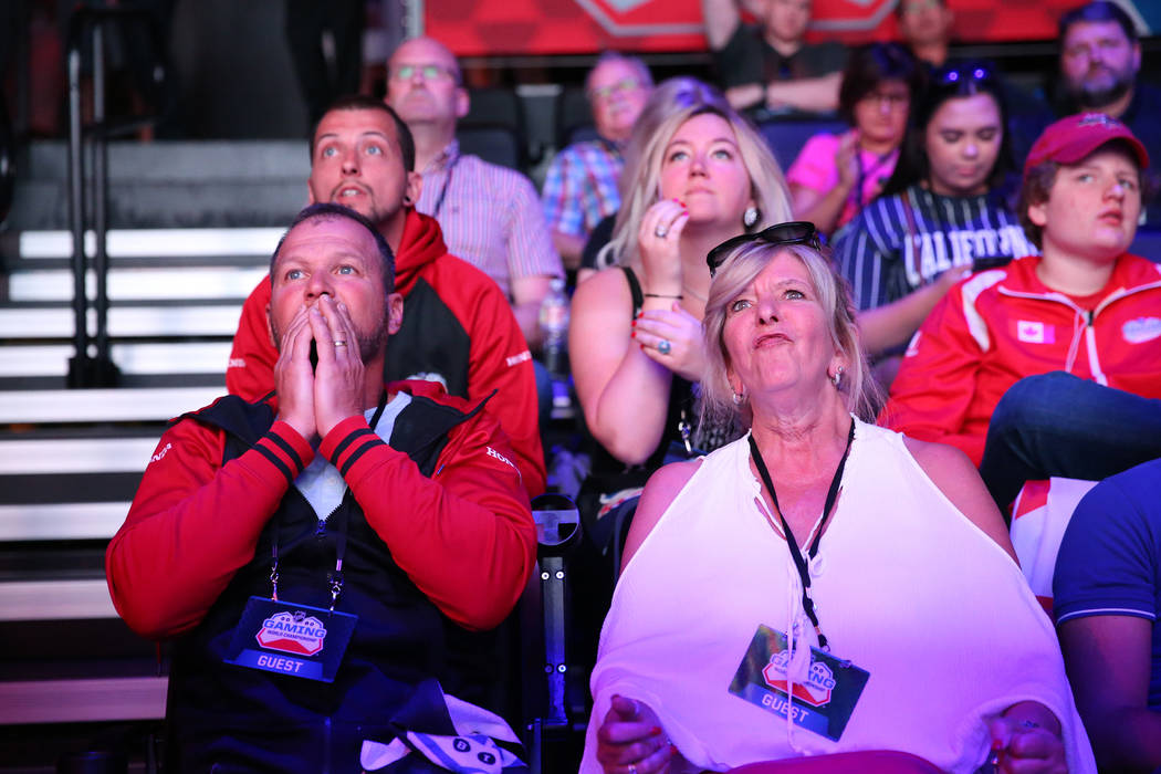 Alfonso Bruna, left, and his wife Martine Jasmin, watch their son Nicola Bruna, not pictured, compete in the NHL Gaming World Championship at Esports Arena inside the Luxor casino-hotel in Las Veg ...
