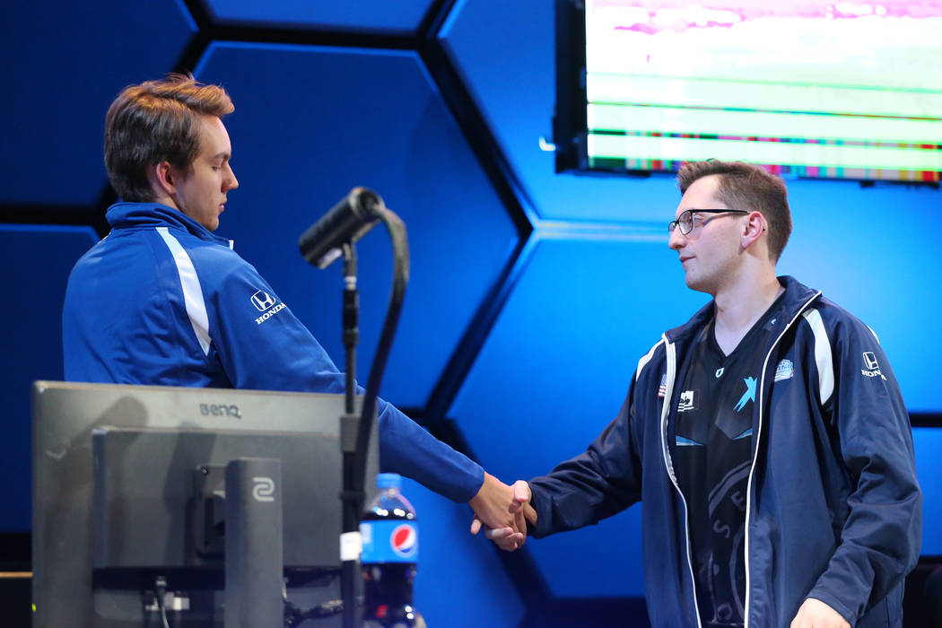 Erik Tammenpaa, left, and David Roebuck, shake hands after competeting in the NHL Gaming World Championship at Esports Arena inside the Luxor casino-hotel in Las Vegas, Tuesday, June 19, 2018. Eri ...