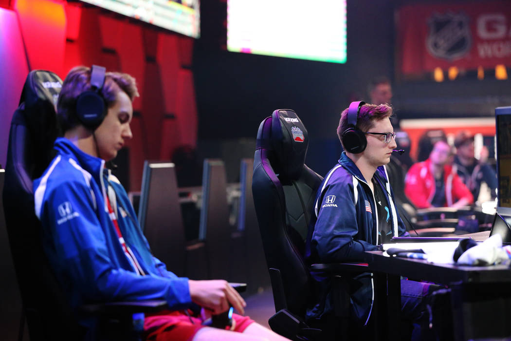 Erik Tammenpaa, left, and David Roebuck, compete in the NHL Gaming World Championship at Esports Arena inside the Luxor casino-hotel in Las Vegas, Tuesday, June 19, 2018. Erik Verduzco Las Vegas R ...