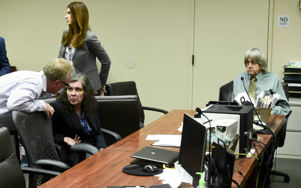Defendant Louise Anna Turpin, second left, talks with an investigator as her husband David Allen Turpin, right, looks on during a May 4, 2018 court appearance in Riverside, Calif. (Watchara Phomic ...