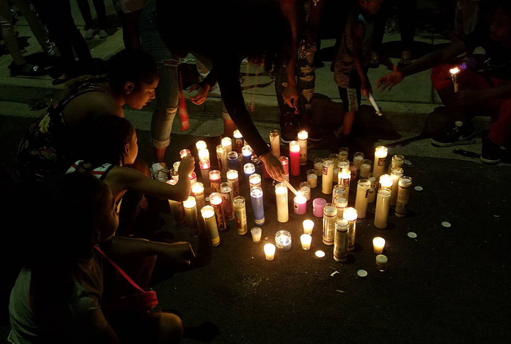 Friends and family members light candles during a Saturday memorial for Justise Allen, 16, who died in a shooting Friday night in Las Vegas. (Mike Shoro Las Vegas Review-Journal)