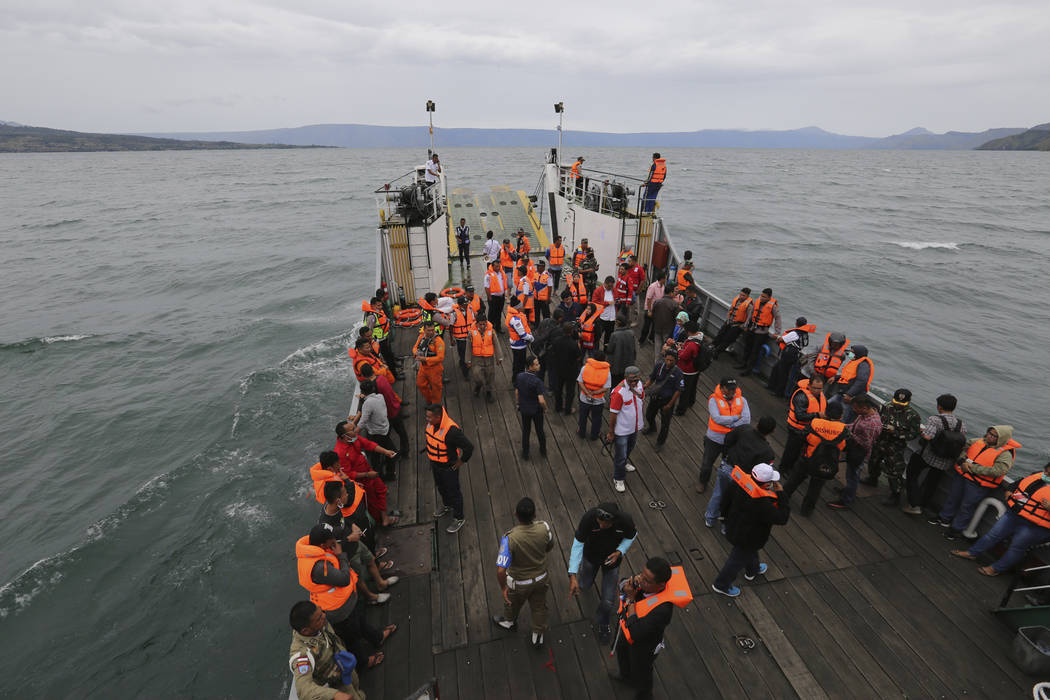 An Indonesia search and rescue team searches for a ferry which sank Monday in lake Toba, North Sumatra, Indonesia, Tuesday, June 19, 2018. Rescuers searching for dozens of people missing after a f ...