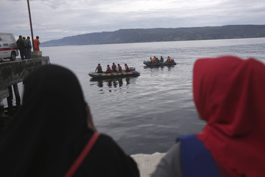 Indonesian search and rescue team on boat searches for a ferry which sank Monday at Tigaras port in Toba lake, North Sumatra, Wednesday, June, 20, 2018. Distraught relatives slammed Indonesia's go ...
