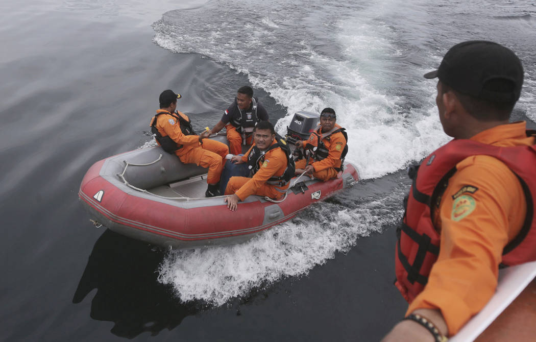 Indonesian rescuers search for a ferry which sank on Monday in Lake Toba, North Sumatra, Indonesia Wednesday, June, 20, 2018. Distraught relatives slammed Indonesia's government for not enforcing ...