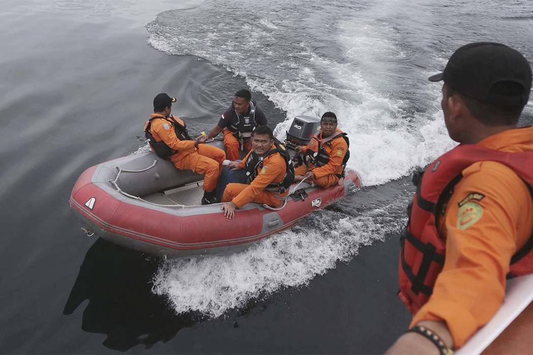 Indonesian rescuers search for a ferry which sank on Monday in Lake Toba, North Sumatra, Indonesia Wednesday, June, 20, 2018. (Binsar Bakkara/AP)