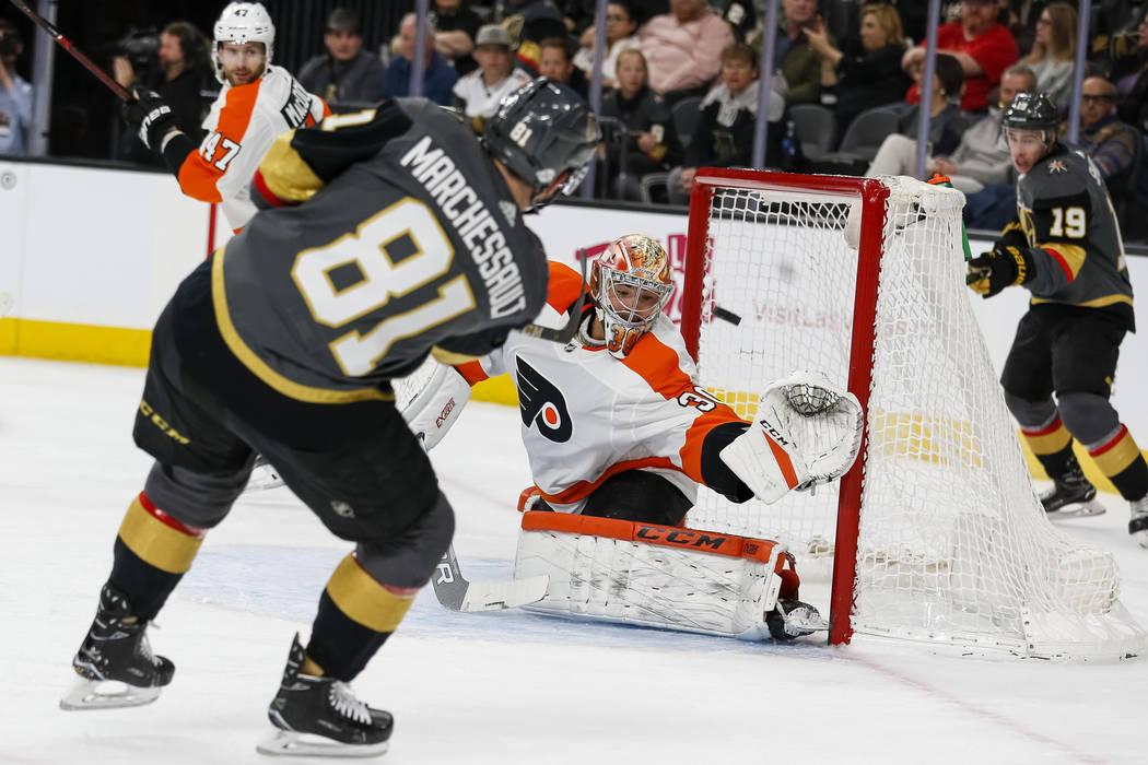 c8456716c Vegas Golden Knights center Jonathan Marchessault (81) takes a shot at  Philadelphia Flyers goaltender