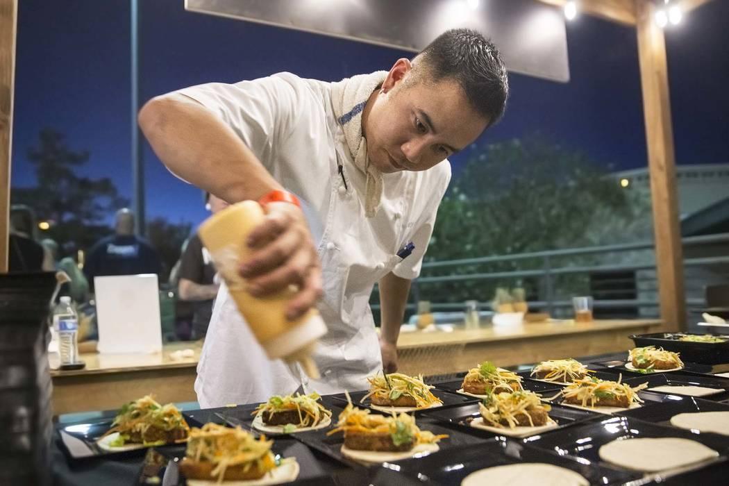 Chef Nicholas Aoki from Herringbone Las Vegas prepares drunken rabbit tacos during the Hopped Taco Throwdown on Saturday, Aug 12, 2017, at Zappos, in Las Vegas. Benjamin Hager Las Vegas Review-Jou ...