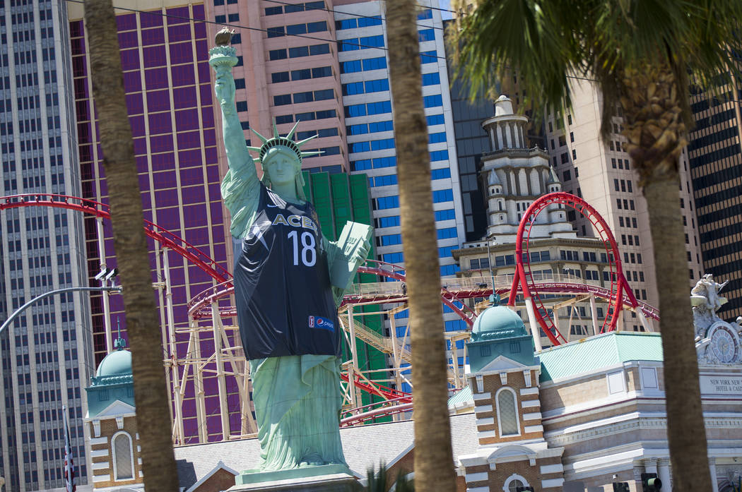 A Las Vegas Aces jersey appears on the Statue of Liberty outside of the New York-New York in Las Vegas on Wednesday, June 20, 2018. Chase Stevens Las Vegas Review-Journal @csstevensphoto