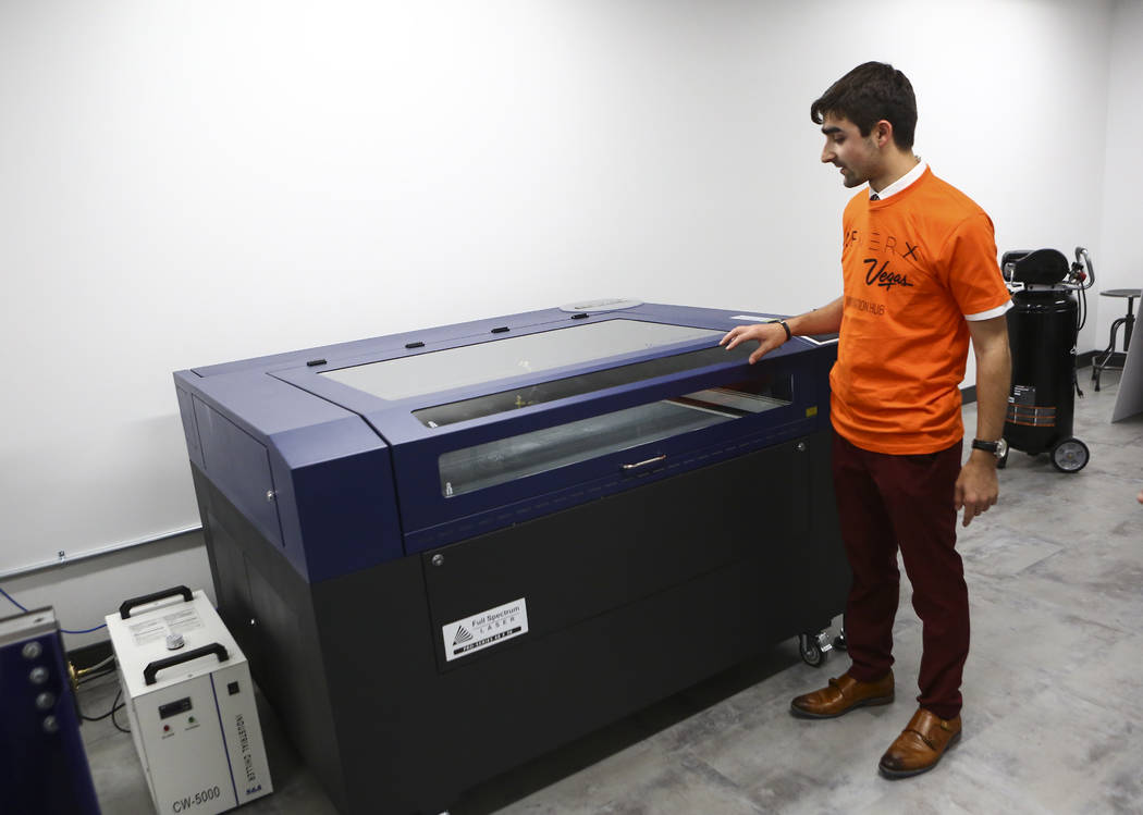 Matthew Viton, prototyping lab coordinator, shows a laser cutter during a tour of the lab at the grand debut of the completed Innovation Center and lab at AFWERX Vegas in Las Vegas on Tuesday, Jun ...