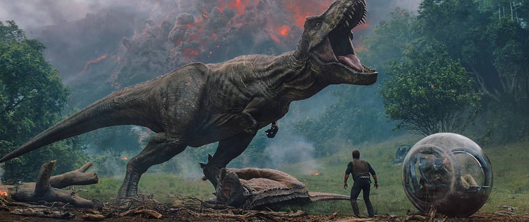 "Owen (CHRIS PRATT) comes between the mighty T. rex and Claire (BRYCE DALLAS HOWARD) and Franklin (JUSTICE SMITH) in ""Jurassic World: Fallen Kingdom."" When the island's dormant volcano begins roar ..."