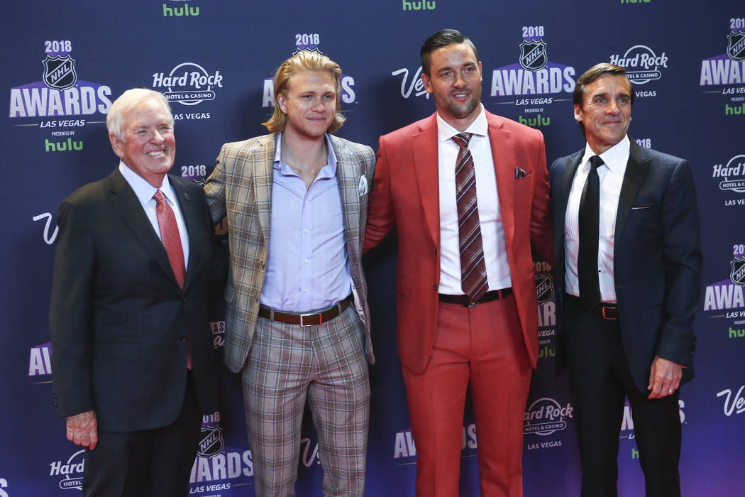 Golden Knights owner Bill Foley, from left, joins players William Karlsson and Deryk Engelland along with George McPhee, general manager, on the red carpet ahead of the NHL Awards at the Hard Rock ...
