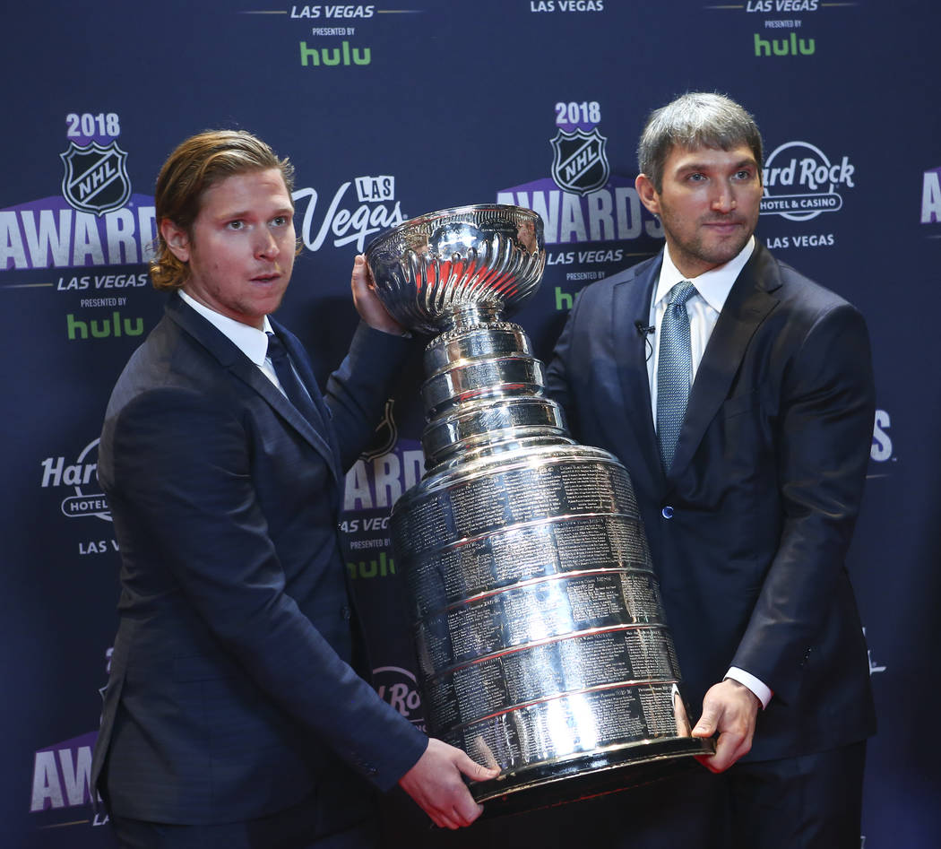 Nicklas Backstrom, left, and Alex Ovechkin of the Washington Capitals pose with the Stanley Cup on the red carpet ahead of the NHL Awards at the Hard Rock Hotel in Las Vegas on Wednesday, June 20, ...