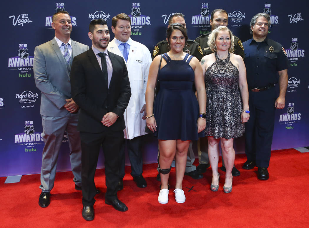 Survivors and first responders in the Oct. 1 shooting, including UNLV Hockey assistant coach Nick Robone, center left, Rylie Golgart, center, and Lori Hosack, right, pose on the red carpet ahead o ...