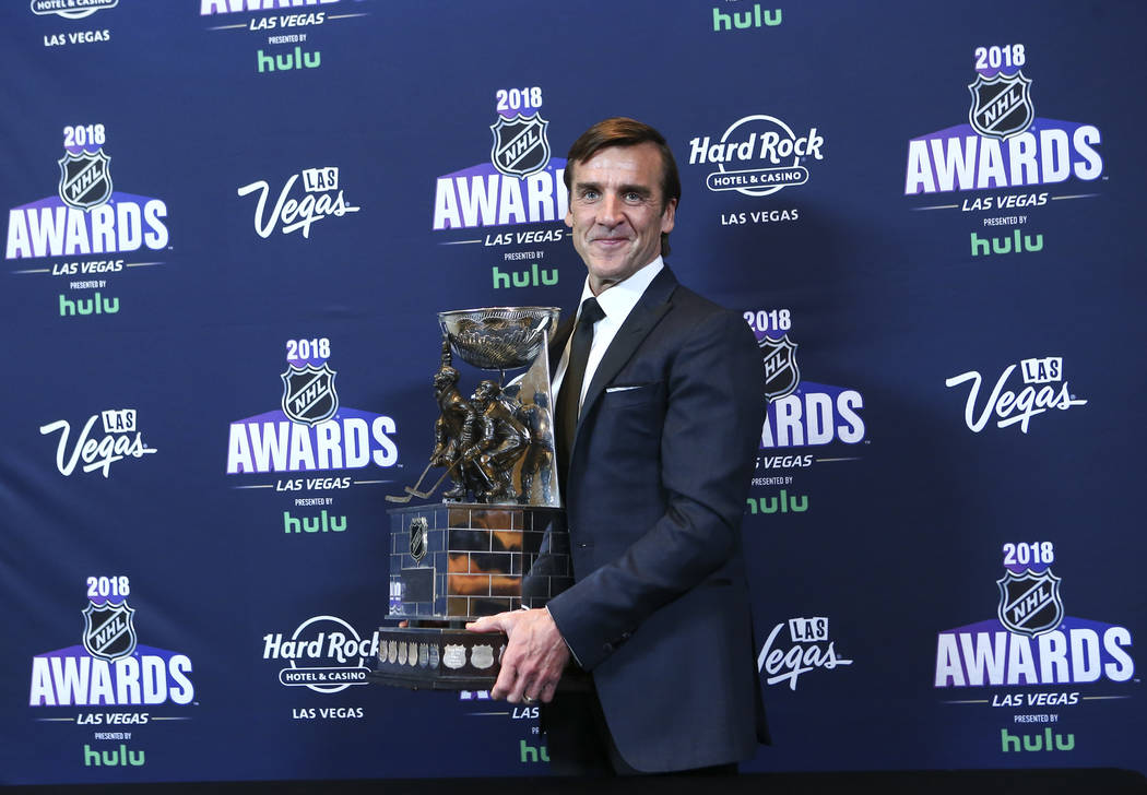 George McPhee, general manager of th Golden Knights, poses with the General Manager of the Year award during the NHL Awards at the Hard Rock Hotel in Las Vegas on Wednesday, June 20, 2018. Chase S ...