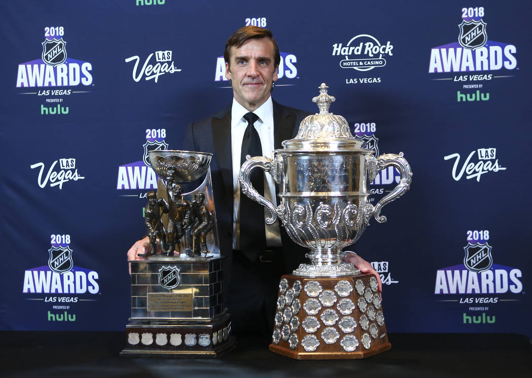 George McPhee, general manager of th Golden Knights, poses with the General Manager of the Year award and the Clarence S. Campbell Bowl during the NHL Awards at the Hard Rock Hotel in Las Vegas on ...
