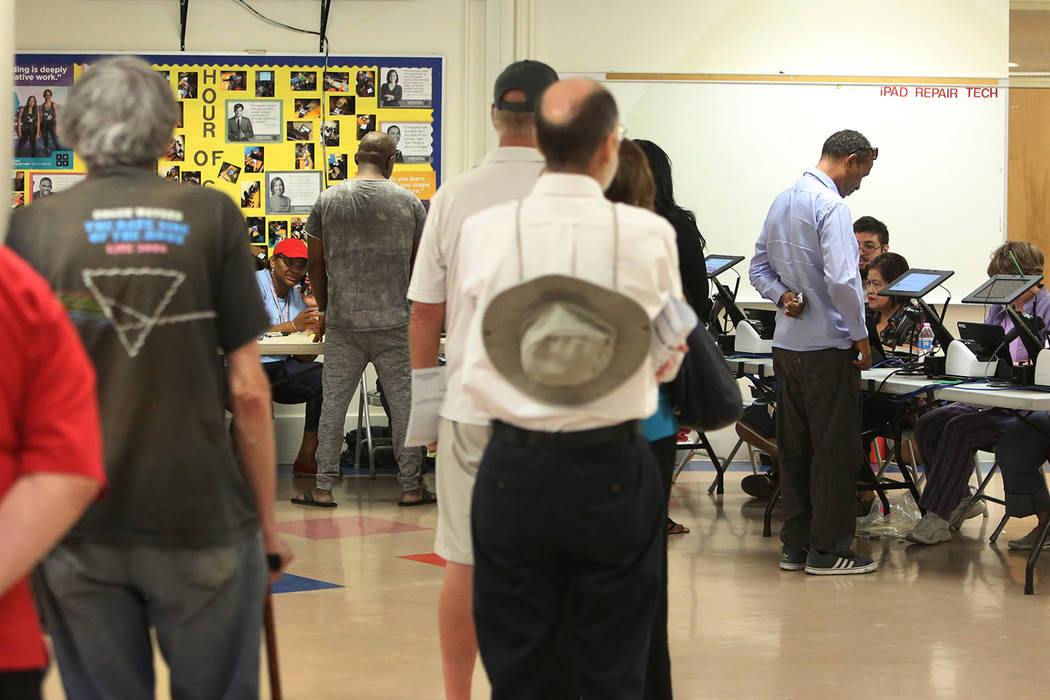 Voters lined up to check in to cast their vote during Tuesday's primary election at a polling station at Kenny G. Guinn Middle School on June 12, 2018, in Las Vegas Bizuayehu Tesfaye/Las Vegas Rev ...