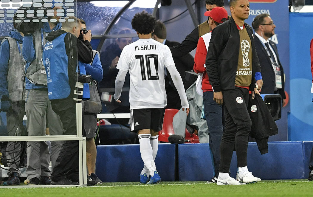 Egypt's Mohamed Salah leaves the pitch without going to his fans, disappointed after losing the group A match between Russia and Egypt at the 2018 soccer World Cup in the St. Petersburg stadium in ...