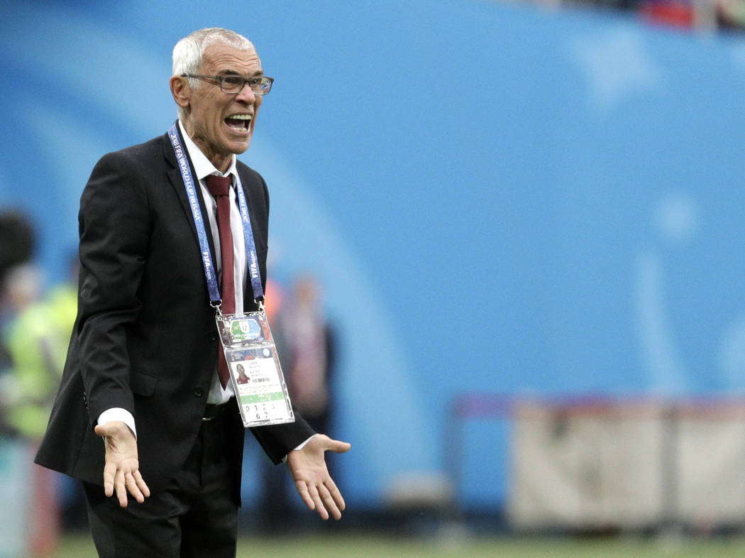 Egypt head coach Hector Cuper shouts during the group A match between Russia and Egypt at the 2018 soccer World Cup in the St. Petersburg stadium in St. Petersburg, Russia, Tuesday, June 19, 2018. ...