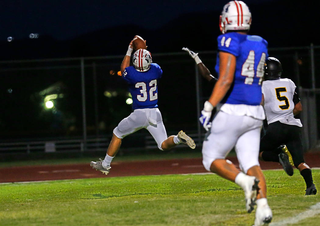 Liberty's Kyle Beaudry (32) runs into the end zone for a touchdown as Saguaro's Antonio Cuevas (5) chases him during the second quarter of a football game at Liberty High School in Henderson, Satu ...