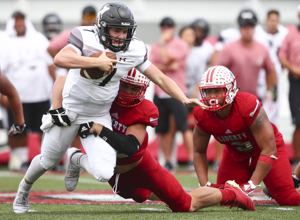 Alta's Will Dana (7) is sacked by Liberty's Kyle Beaudry (32) during a football game at Sam Boyd Stadium in Las Vegas on Saturday, Sept. 9, 2017. Liberty won 28-7. Chase Stevens Las Vegas Review-J ...
