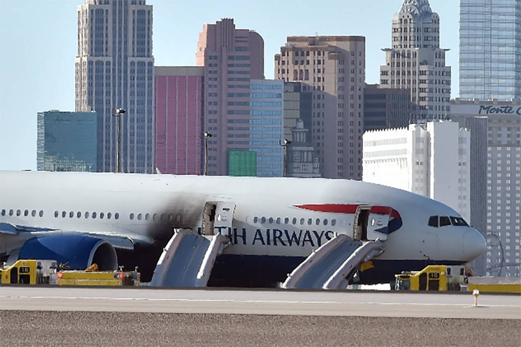 A British Airways passenger jet is parked on the runway after an onboard fire broken out at McCarran International Airport on Tuesday, Sept. 8, 2015. (Las Vegas Review-Journal)