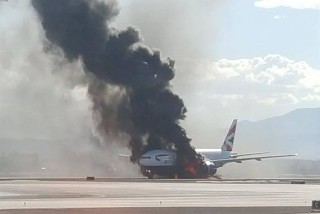 A British Airways passenger jet catches fire at McCarran International Airport on Tuesday, Sept. 8, 2015. (@fresconews/Twitter)