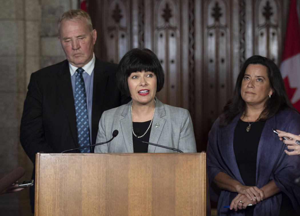 Minister of Health Ginette Petitpas Taylor, center, Minister of Justice and Attorney General of Canada Jody Wilson-Raybould, right, and Parliamentary Secretary to the Minister of Justice and Attor ...