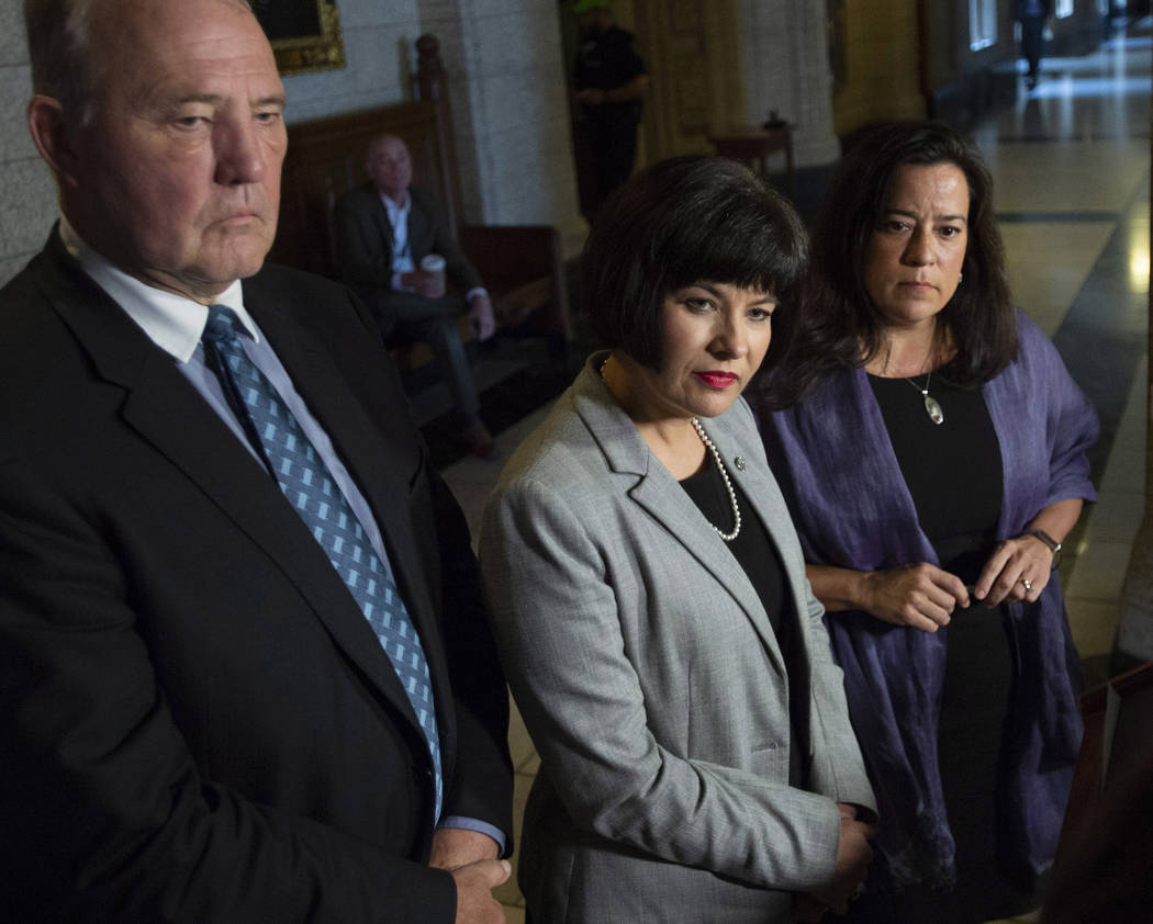 Minister of Justice and Attorney General of Canada Jody Wilson-Raybould, right, Minister of Health Ginette Petitpas Taylor, center, and Parliamentary Secretary to the Minister of Justice and Attor ...