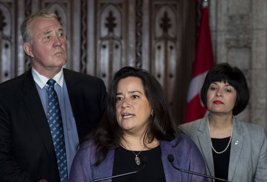 Minister of Justice and Attorney General of Canada Jody Wilson-Raybould speaks during a press conference as Minister of Health Ginette Petitpas Taylor, right, and Parliamentary Secretary to the Mi ...