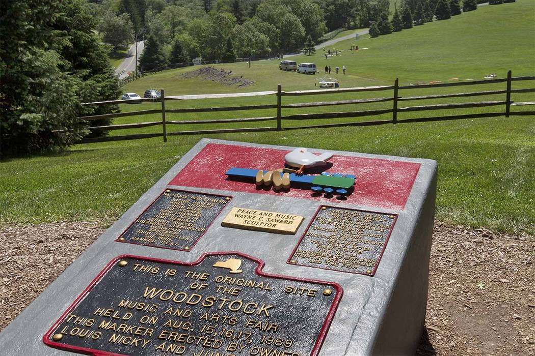 In this June 14, 2018 photo, members of the Public Archaeology Facility at Binghamton University work at the site of the 1969 original Woodstock Music and Art Fair, in Bethel, N.Y. Information fro ...