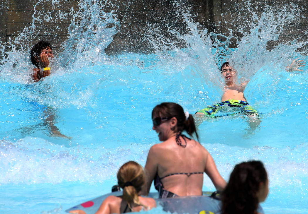 Parkgoers play on a hot day at Surf-A-Rama Wave Pool at Cowabunga Bay Park on Wednesday, June 20, 2018, in Henderson. Bizuayehu Tesfaye/Las Vegas Review-Journal @bizutesfaye
