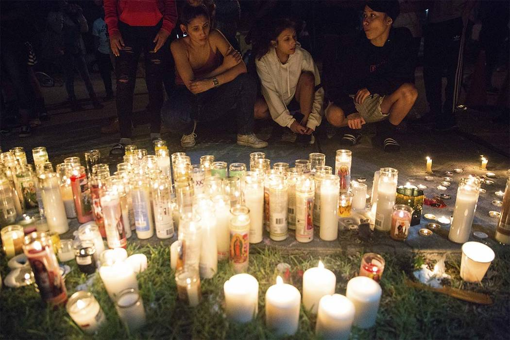 In this Tuesday, June 19, 2018 photo, fans and community members gather at the vigil for rap singer XXXTentacion in Deerfield Beach, Fla., near the site where the troubled rapper-singer was killed ...