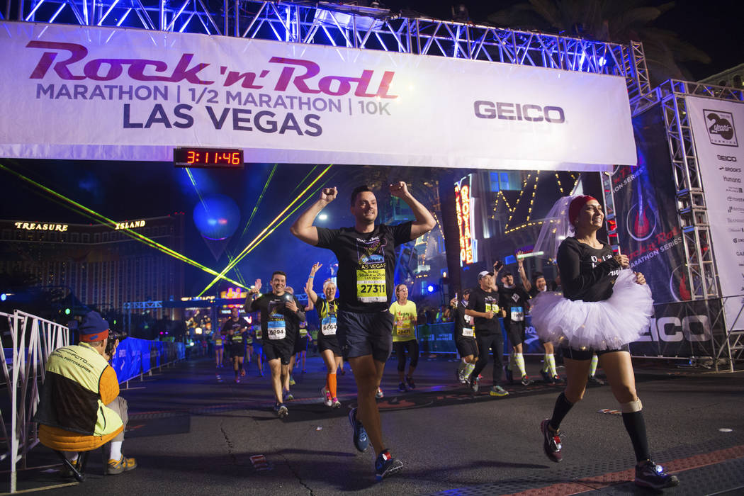 Participants cross the finish line during the Rock 'n' Roll Las Vegas Marathon on Nov. 12. (Sam Morris Las Vegas News Bureau)