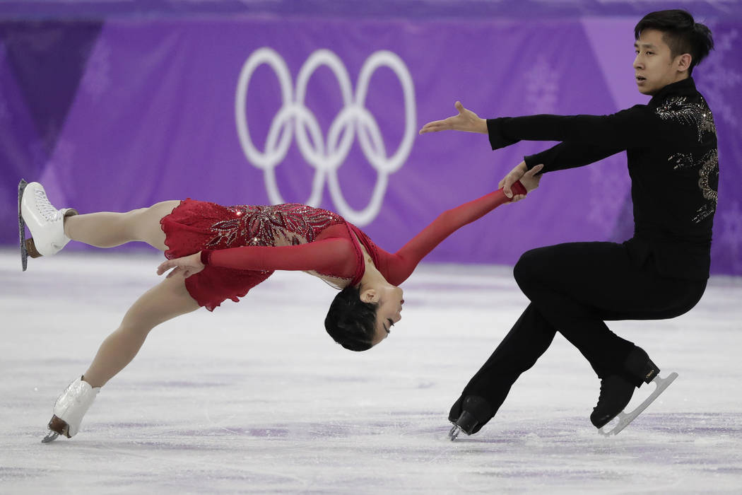 Sui Wenjing and Han Cong of China perform in the pairs free skate figure skating final in the Gangneung Ice Arena at the 2018 Winter Olympics in Gangneung, South Korea, Thursday, Feb. 15, 2018. (A ...