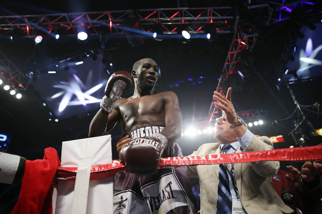 Terence Crawford celebrates his technical knockout win against Jeff Horn in the WBO welterweight World Title bout at the MGM Grand Garden Arena in Las Vegas, Saturday, June 9, 2018. Crawford won b ...