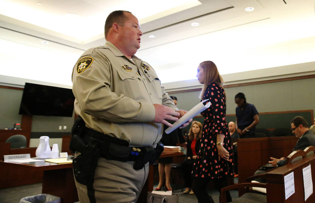Las Vegas police officer Jeremy Robertson after speaking during the sentencing hearing for Clemon Hudson and Steven Turner, who were convicted of attempted murder for their roles in shooting Rober ...