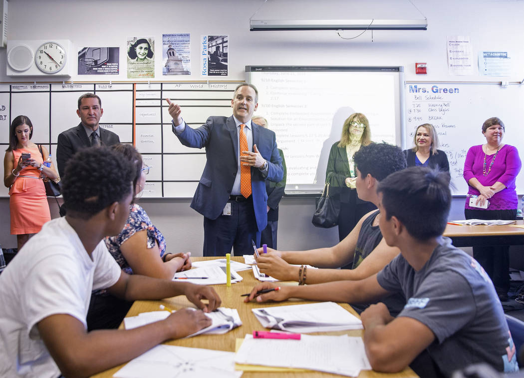 Clark County School District Superintendent Jesus F. Jara, middle, speaks with students in a social studies class during a tour of Del Sol Academy of the Performing Arts on Thursday, June 21, 2018 ...