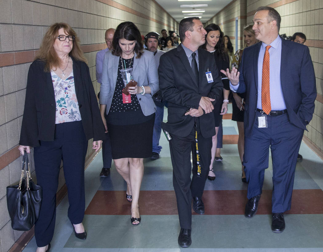Clark County School District Superintendent Jesus F. Jara, right, speaks with CCSD principle Gregory Misel, middle, during a tour of Del Sol Academy of the Performing Arts on Thursday, June 21, 20 ...