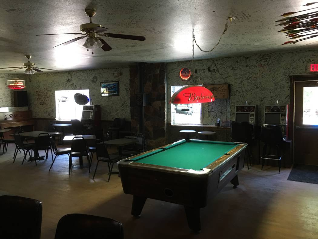 Two of the four quarter slot machines licensed Thursday, June 21, 2018, by the Nevada Gaming Commission are next to the pool table at the Outdoor Inn in Jarbidge, Nevada. (Courtesy of Jason Stegall)