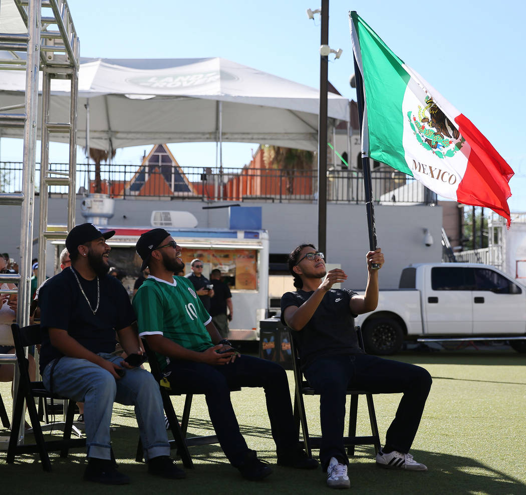 Adrian Espinoza, from left, Ernan Aguilar, and Samuel Navarro, during a watch party for the World Cup soccer match between Mexico and South Korea at the Downtown Las Vegas Events Center in Las Veg ...