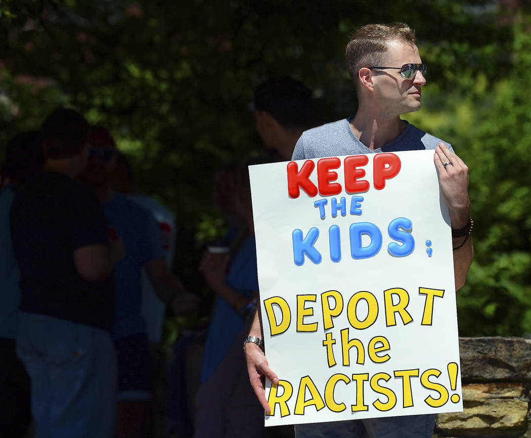 FILE - In this June 15, 2018 file photo, Chris Olson, of Lake Wallenpaupack, Pa., holds a sign outside Lackawanna College where U.S. Attorney Jeff Sessions spoke on immigration policy and law enfo ...