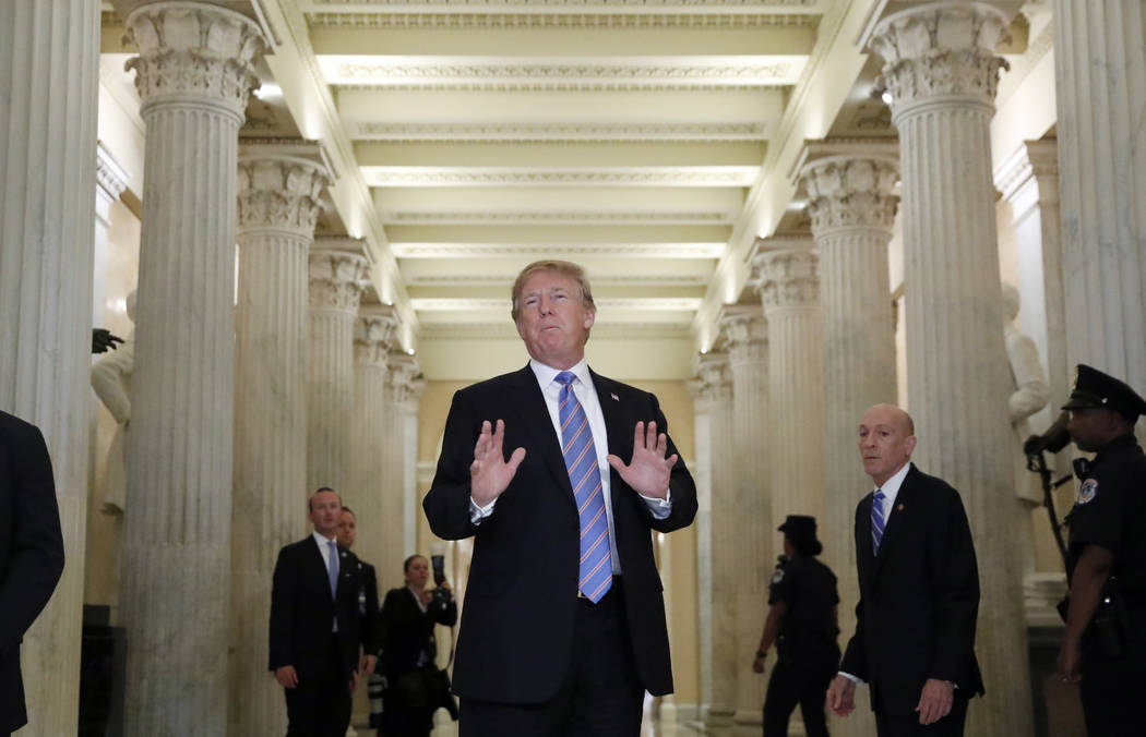 President Donald Trump speaks in the Hall of Columns as he arrives on Capitol Hill in Washington, Tuesday, June 19, 2018, to rally Republicans around a GOP immigration bill. (AP Photo/Alex Brandon)