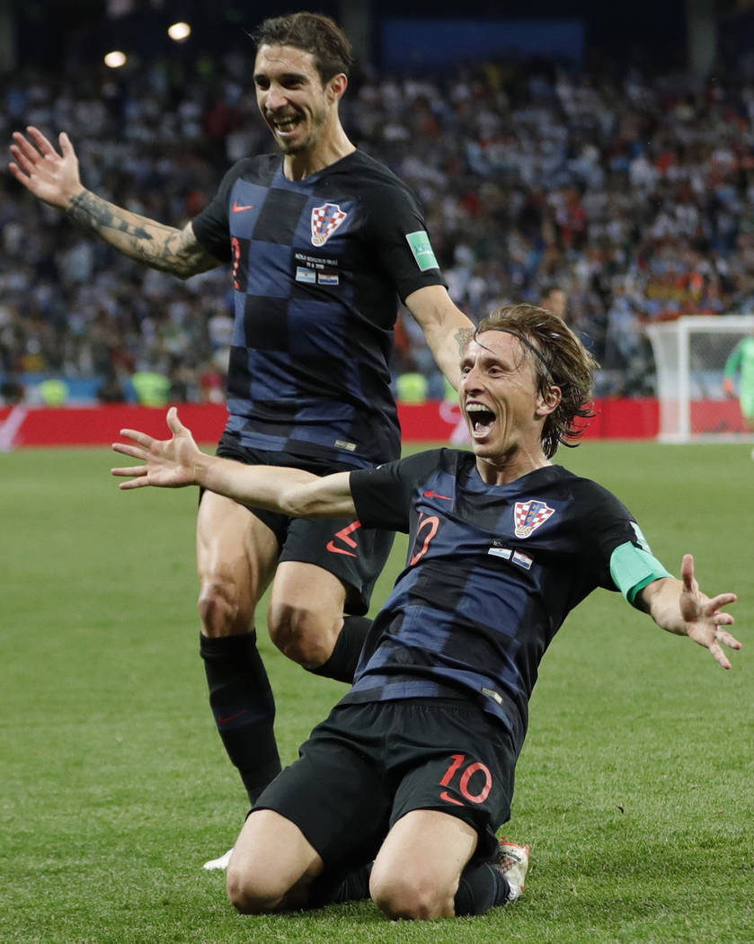 Croatia's Luka Modric, right, celebrates after scoring his side's second goal during the group D match between Argentina and Croatia at the 2018 soccer World Cup in Nizhny Novgorod Stadium in Nizh ...
